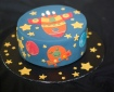 Cake decorated with rocket ship patterns
