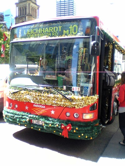 Red bus covered in tinsel and other Christmas decorations