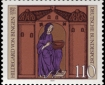 Postage stamp showing medieval woodcut of nun in blue robe.