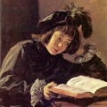 A 15th century painting of a boy reading, artist Frans Hals
