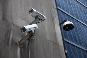 Surveillance cameras attached to a building exterior