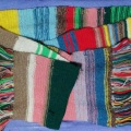 A very old and scraggly woollen scarf, knitted in rows of many colours a la Tom Baker, the 4th Doctor