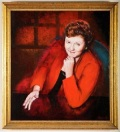 A portrait in oils of a woman wearing a red jacket and a pleasantly determined expression, resting her chin on one hand while gesturing towards the viewer with the other hand. She appears to have just made a persuasive argument.