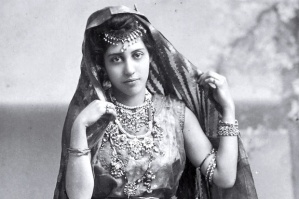 B&W photo of young Indian woman in traditional dress.