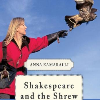 Woman releasing falcon.