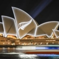 A silver fern projected onto sail structure of Sydney Opera House